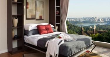 Интерьер спальни с видом на город