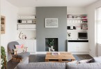 Интерьер светлой гостиной в серых тонах