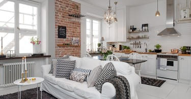 Кирпичная кладка в интерьере белой кухни