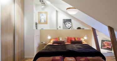 Интерьер спальни мансардного типа