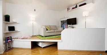 Интерьер маленькой квартиры-студии необычной формы