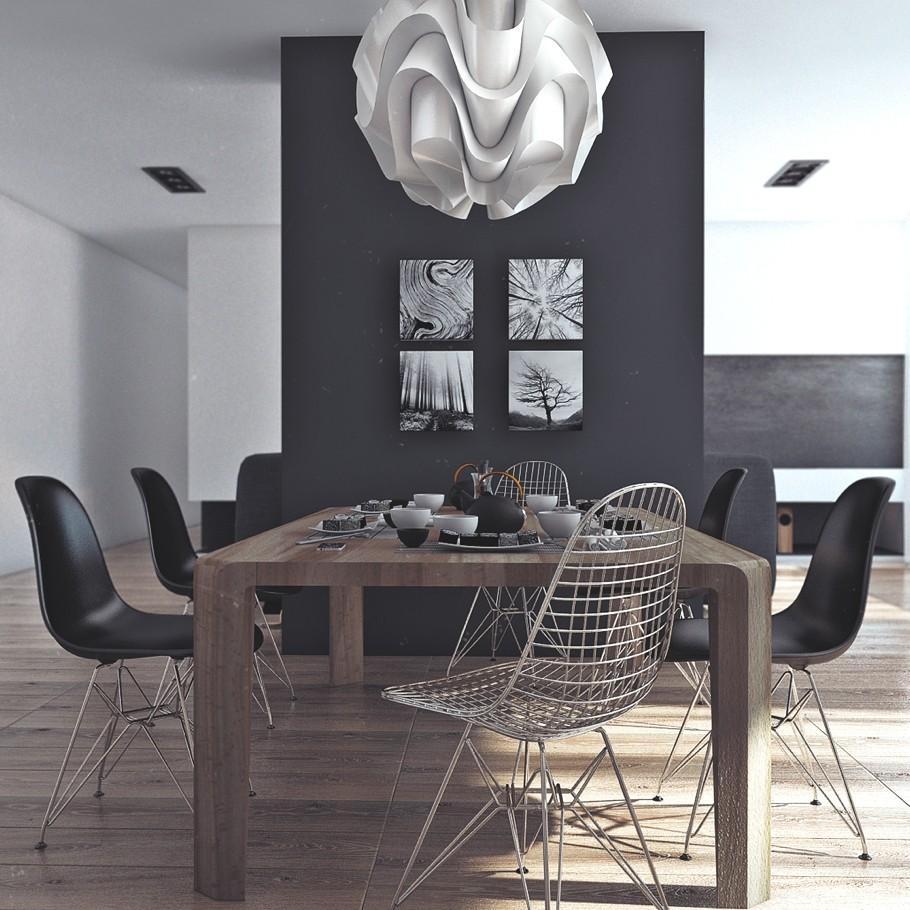 Деревянный обеденный стол, чёрные стулья и оригинальные картины на чёрной стене