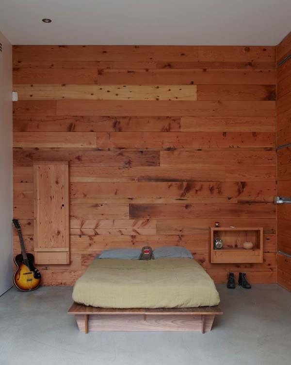 Спальня в минималистическом стиле, оформленная деревом