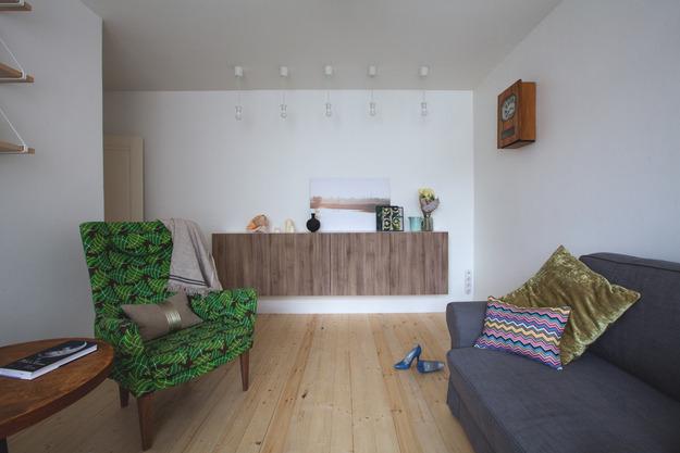 Интерьер гостиной в трёхкомнатной квартире