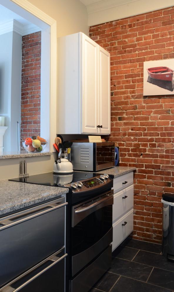 Интерьер маленькой квартиры: кухня с барной стойкой