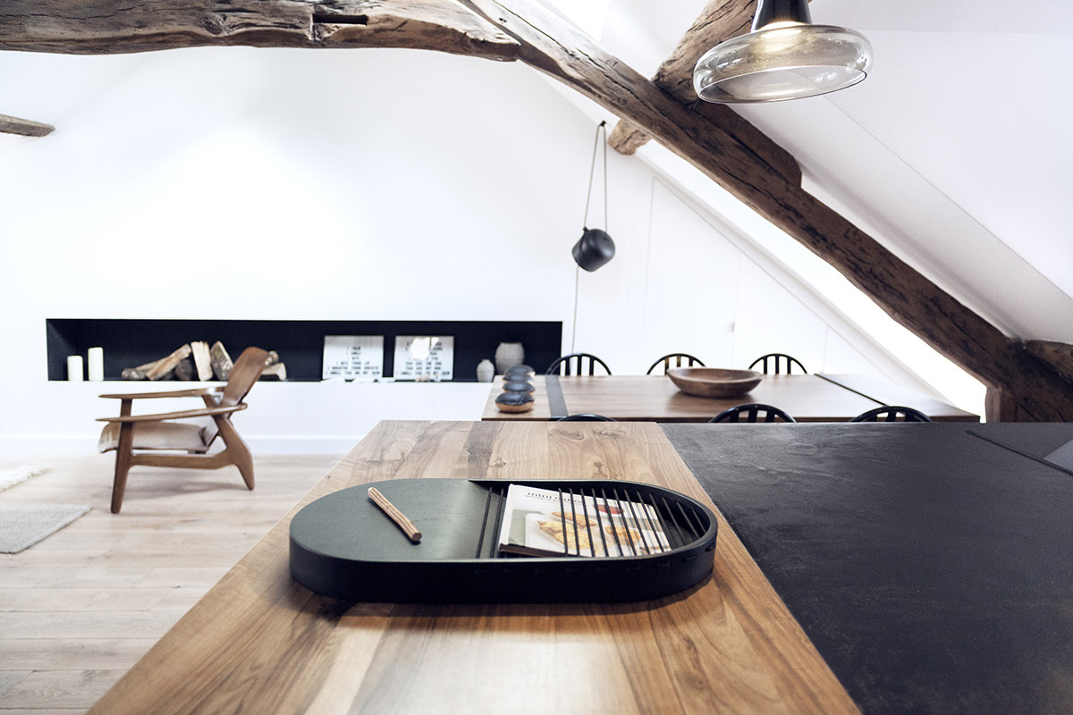 Remodeled attic apartment in paris unfinished wood beams