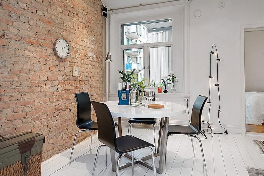 Столовая квартиры-студии в скандинавском стиле