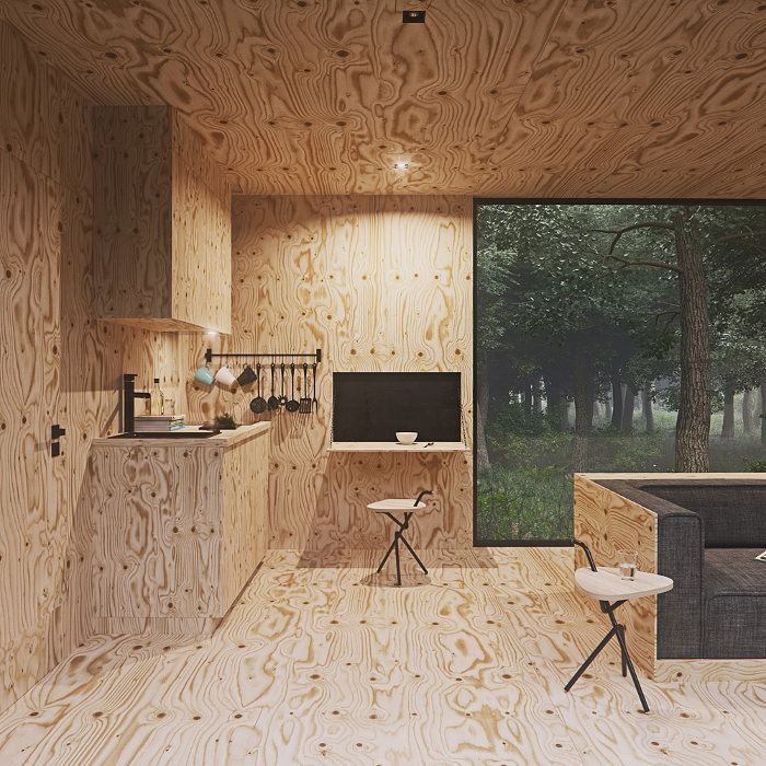 Интерьер маленького домика Tomek Michalski Cabin в лесу