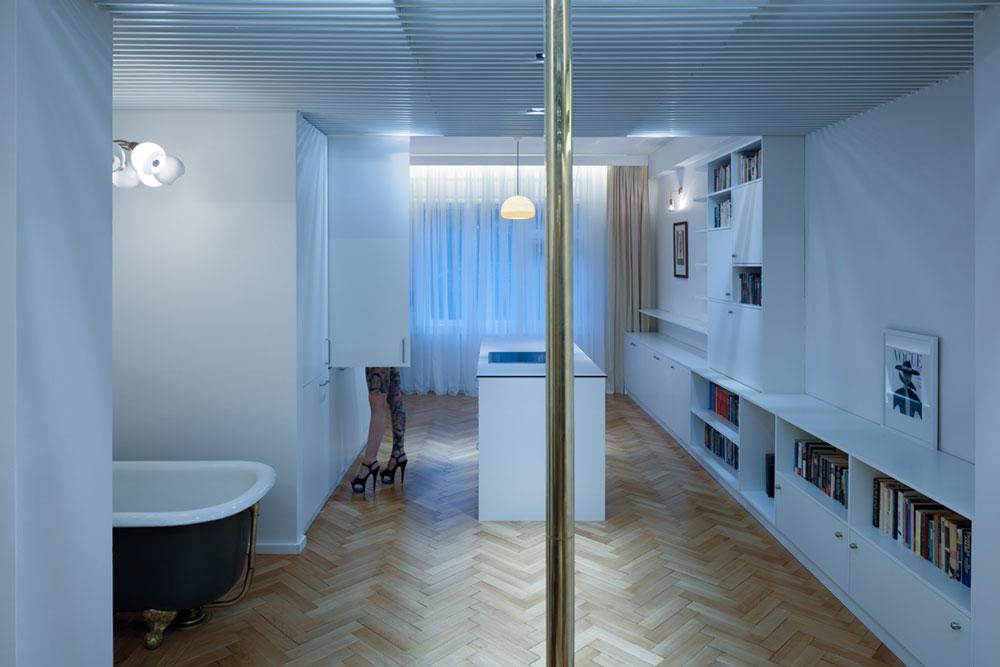 Cовременный дизайн небольшой квартиры  - панорамное окно и система отопления на потолке