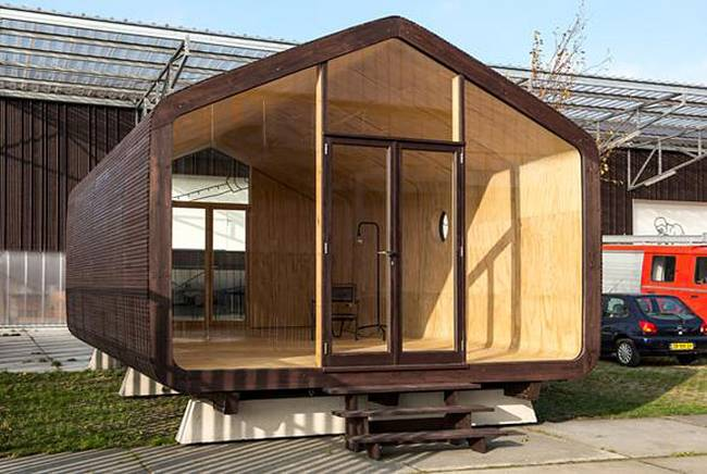 Проект маленького жилого дома. Сосна придает дому элегантный и классический облик